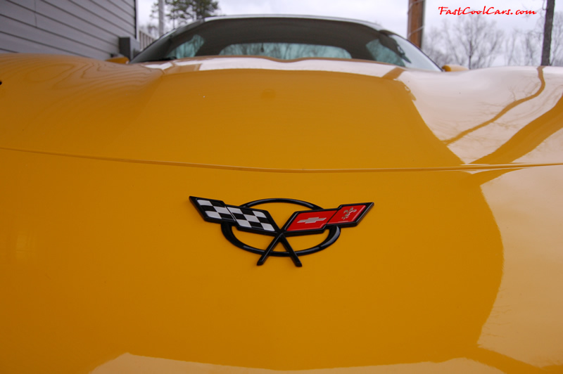 2002 Millennium Yellow Z06 Corvette - 405 HP Stock - C5 logo emblem on front of vette.