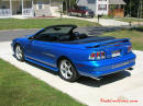 1998 Mustang Cobra Convertible - 1 of 223 - Electric blue, with top down, and stainless Cobra letters