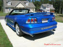 1998 Mustang Cobra Convertible - 1 of 223 - Electric blue, with top down, and shiny mirror finished stainless Cobra letters.