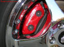 View of painted caliper on 1998 Cobra convertible through the chrome 2000 Cobra wheel.