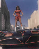 The Original Batmobile from the series in 1966-68 TV series with girl standing on batmobile