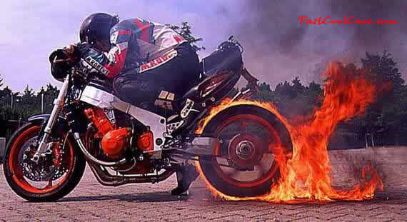 Pretty young lady roasting the tire off this superbike