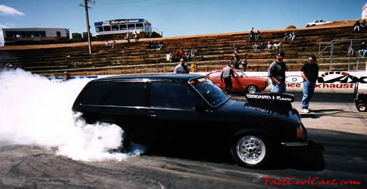 wagon doing big burnout, right hand drive