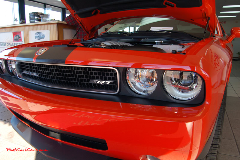 2009 Dodge Challenger SRT8 - 6.1 Hemi with 425HP, and this one is a 6 speed cool front end and headlights too.