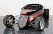 Chip Foose's space-age hotrod, called simply the Foose Coupe, is an exercise in the extremes of automotive design and materials.