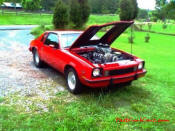 Supercharged dual quad V8 Chevy Monza.