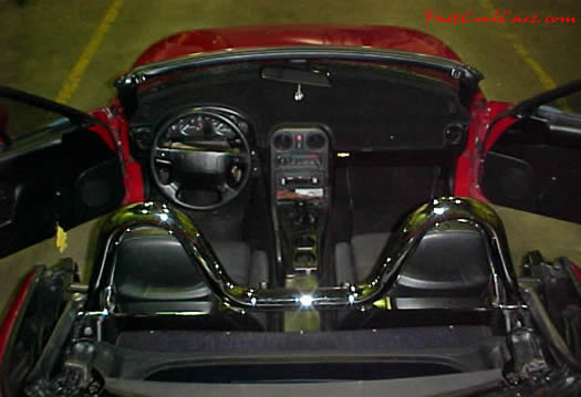 1990 Mazda Miata Roadster - check out the chrome roll bar, 5 speed, little red sports car.