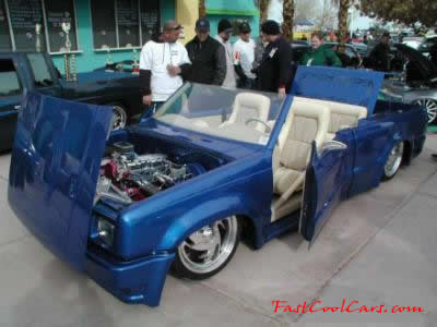 Lowriders that have been lowered, dropped, slammed, and scraping, using many different modifications.