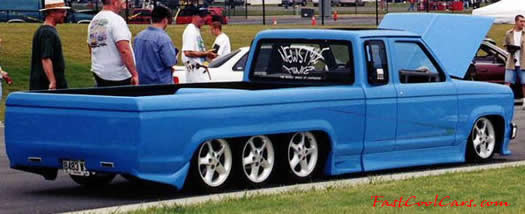 Lowrider Pick-up that has been lowered, dropped, slammed, and scraping, using many different modifications.
