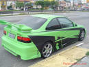 Lowriders that have been lowered, dropped, slammed, and scraping, using many different modifications. Lime green