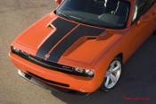 New Dodge Challenger, 6.1 V8 Hemi, 425 crank horsepower, 420 crank foot pounds of torque. SRT8, carbon fiber shows through hood paint.