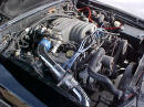 Right side view of under the hood of 91' LX coupe 5.0 H.O. - chrome cold air intake with K&N filter, performance wires, underdrive pulley, daily driver
