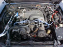 Front view of under the hood of 91' LX coupe 5.0 H.O. - chrome cold air intake with K&N filter, performance wires, underdrive pulley, daily driver
