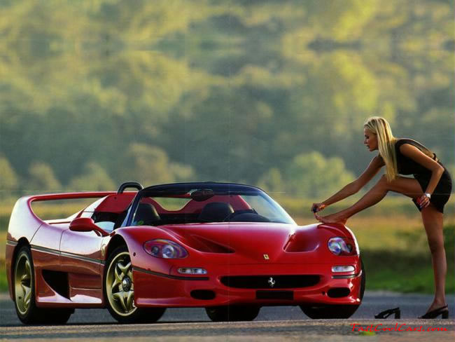 Nice Ferrari with woman painting her toe nails on the fender...lol