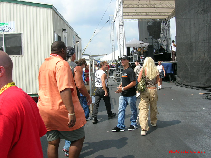 Hulk Hogan, his wife Linda, and their son Nick about to go up on stage to make some announcements.