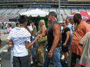Hulk Hogan stopping a moment to talk to a guy while on there way to the stage for announcements, with his wife Linda, and their son Nick.
